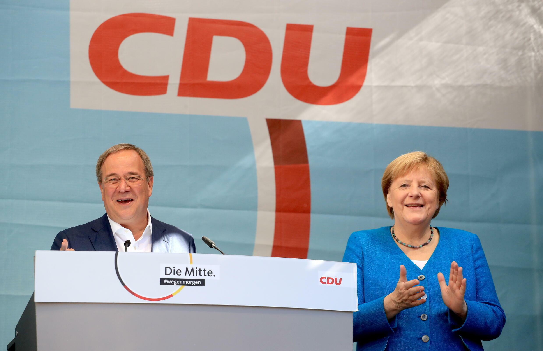 2021-09-25T104605Z_837543491_RC2YWP9GXIW2_RTRMADP_3_GERMANY-ELECTION-CDU-MERKEL-LASCHET