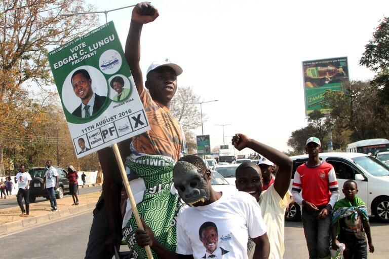 Lungu supporters celebrate in the streets of Lusaka after he was declared winner of the elections, 15 August 2016.