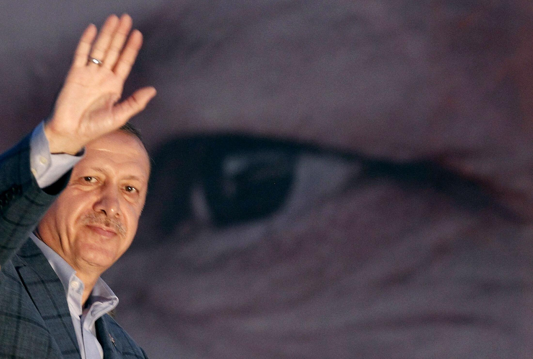 Recep Tayyip Erdogan waves to supporters on Sunday evening
