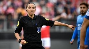 French referee Stephanie Frappart gestures during the French L2 football match between Valenciennes and Beziers on April 19, 2019 in Valenciennes. Stephanie Frappart has been selected among 27 referees for the 2019 World Cup in France.
