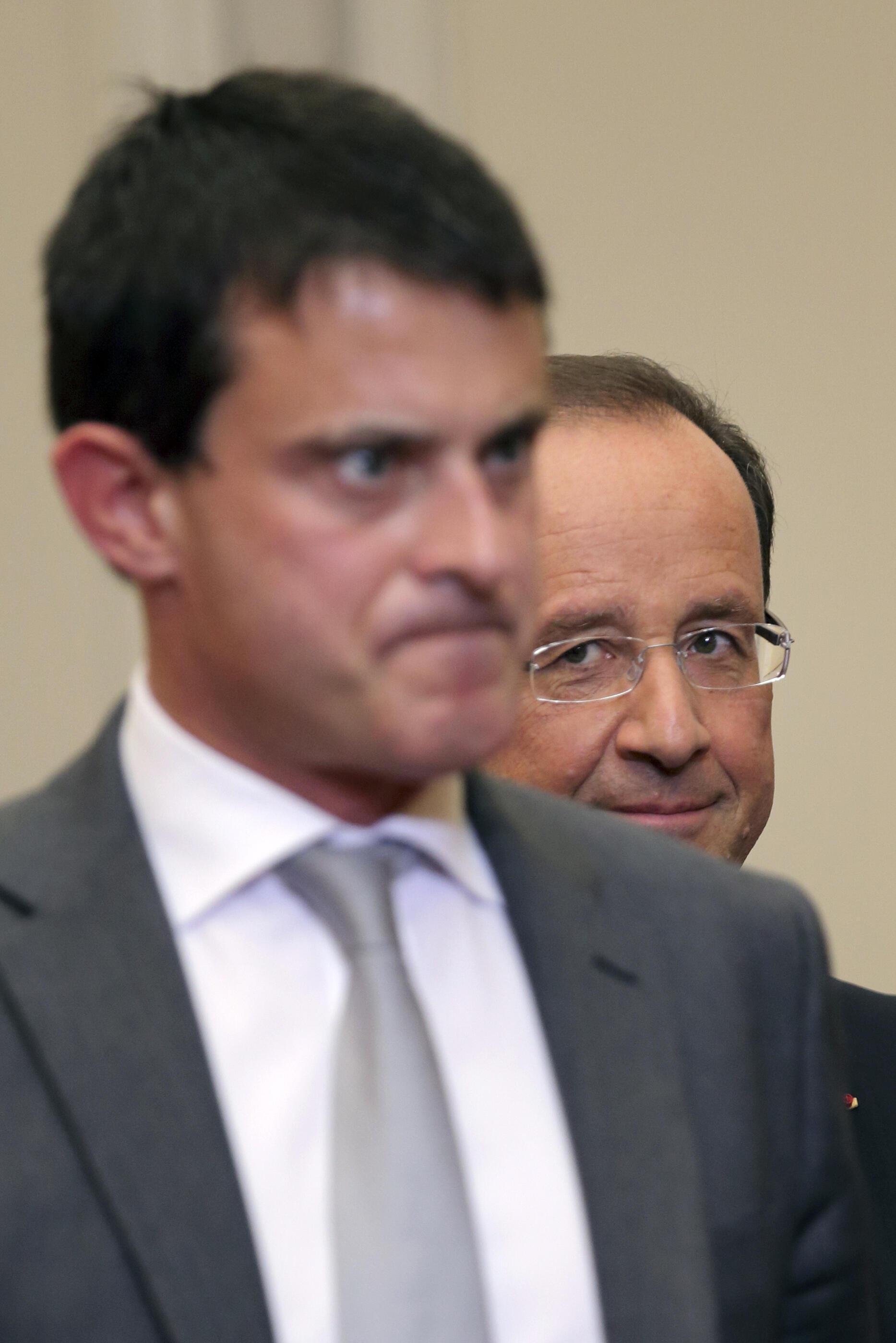 Премьер-министр Манюэль Вальс и президент Франсуа Олланд