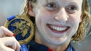 Katie Ledecky broke her own world record to claim the 800m freestyle world title. It was her fifth gold medal in Kazan.