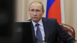 O presidente russo, Vladimir Putin, aliado dos regimes sírio e iraniano.