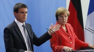 Le Premier ministre français Manuel Valls et la chancelière allemande Angela Merkel, à Berlin le 22 septembre 2014.