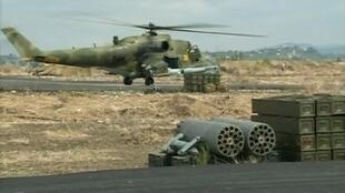 A still image taken from a October 6, 2015 footage shows a Russian air force helicopter on the tarmac of Heymim air base near the Syrian port town of Latakia.