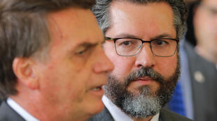 """Brazilian Foreign Minister Ernesto Araujo (right) has been a key member of the so-called """"ideological wing"""" of far-right President Jair Bolsonaro's administration"""