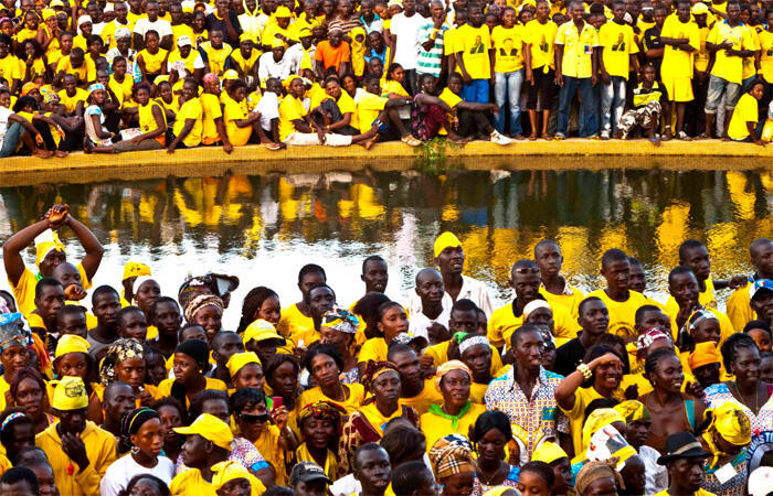 Supporters of presidential candidate for Guinea Alpha Conde attend a campaign rally in Conakry