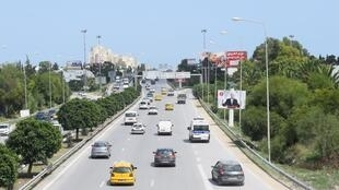 Overpass looks onto billboards of only a few of the 26 candidates in Tunis, September 12 2019