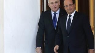 Francois Hollande and Jean-Marc Ayrault at the Elysee Palace in Paris