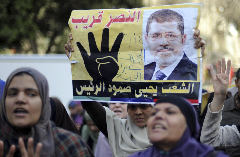Những người  Huynh đệ Hồi giáo biểu tình bày tỏ ủng hộ với cựu Tổng thống Mohamed Morsi ngày 14/2/2014