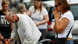 | A woman prays in front of the house of Father Jacques Hamel in Saint-Etienne-du-Rouvray, where the priest was killed in the latest of a string of attacks against Western targets claimed by or blamed on the Islamic State jihadist group
