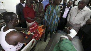 Nigerian Defence Minister Adetokunbo Kayode on a visit to bomb victims in Abuja, 1 January.
