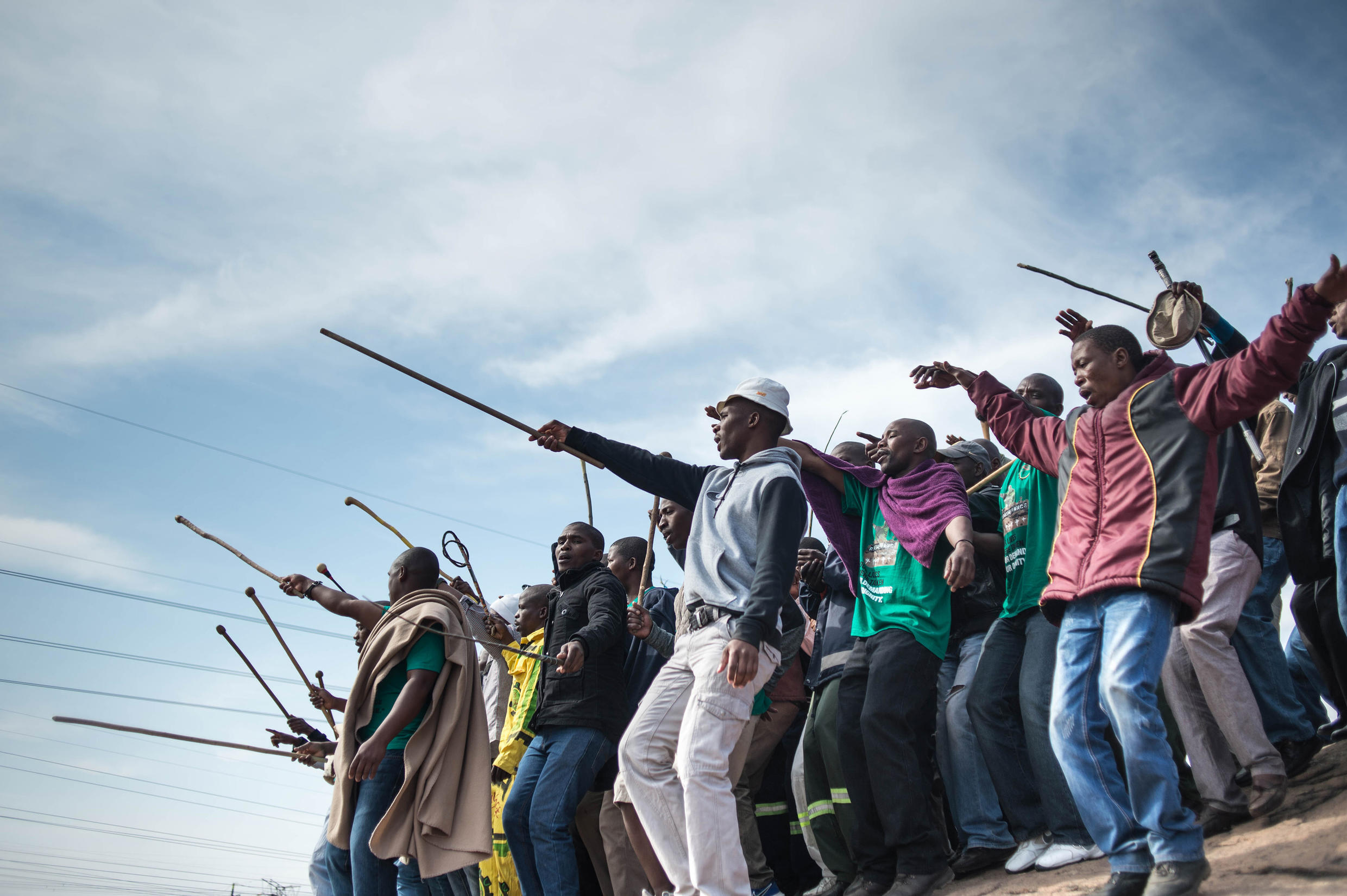 Miners during a commemoration marking the massacre at the Marikana mine, South Africa