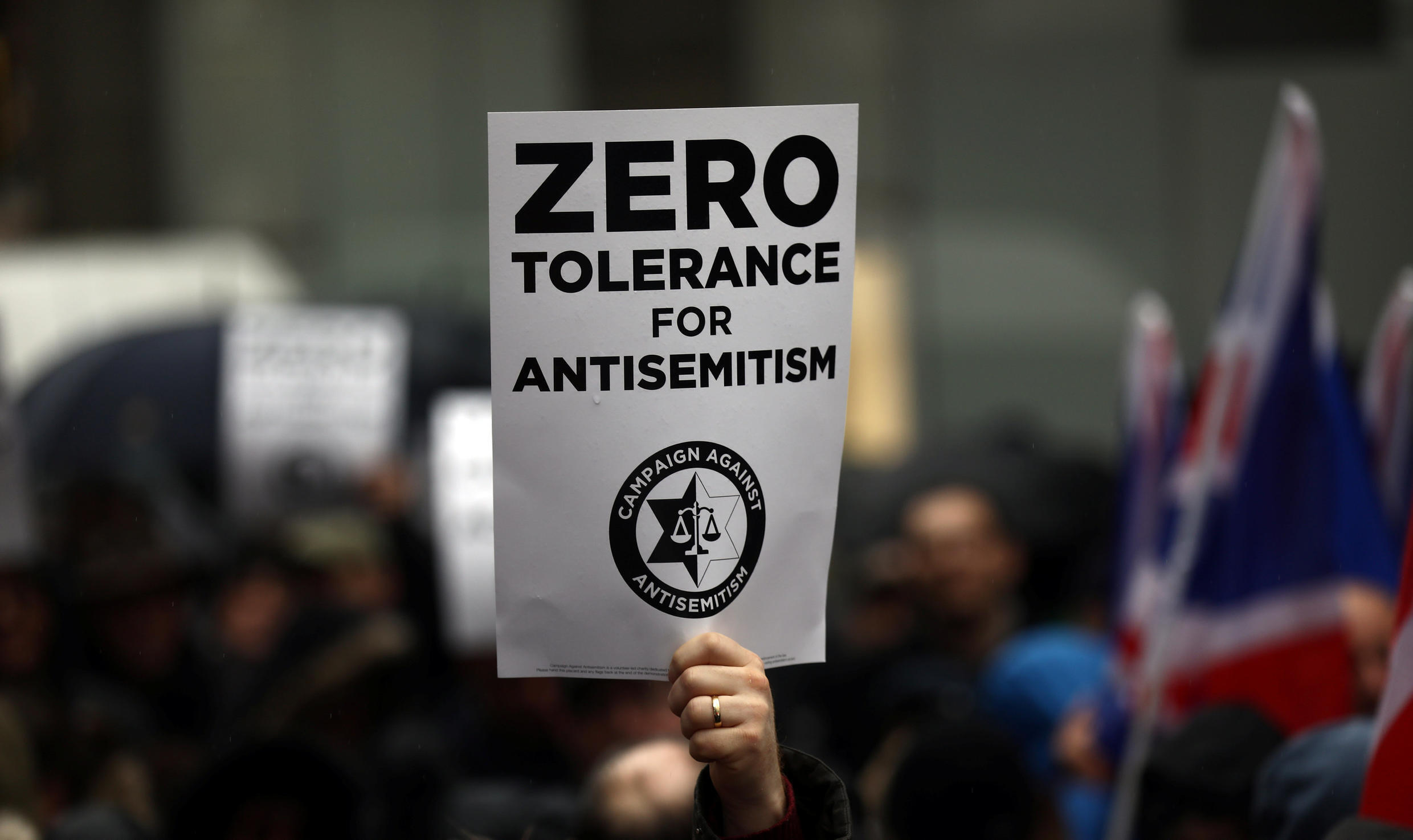 Demonstrators take part in an antisemitism protest outside the Labour Party headquarters in central London, Britain April 8, 2018.