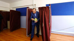 Turkey's President Erdogan arrives at a polling station in Istanbul to vote on April 16, 2017