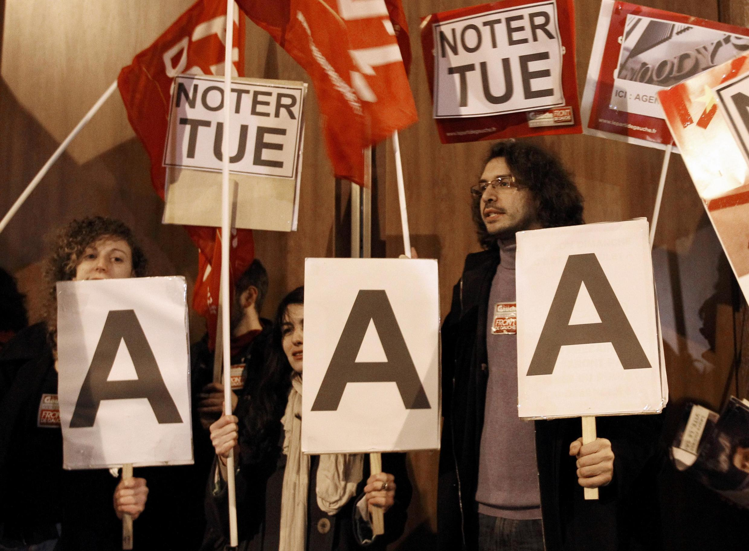Members of left-wing Parti de Gauche political party demonstrate outside the offices of Standard and Poor's in Paris on Friday