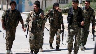 Membres des milices kurdes YPG à Qamichli en Syrie le 22 avril 2016.