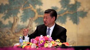 Ông Tập Cận Bình phát biểu tại hội nghị bàn tròn các nhà quản trị cao cấp toàn cầu ở Điếu Ngư Đài, Bắc Kinh, 21/06/2018.