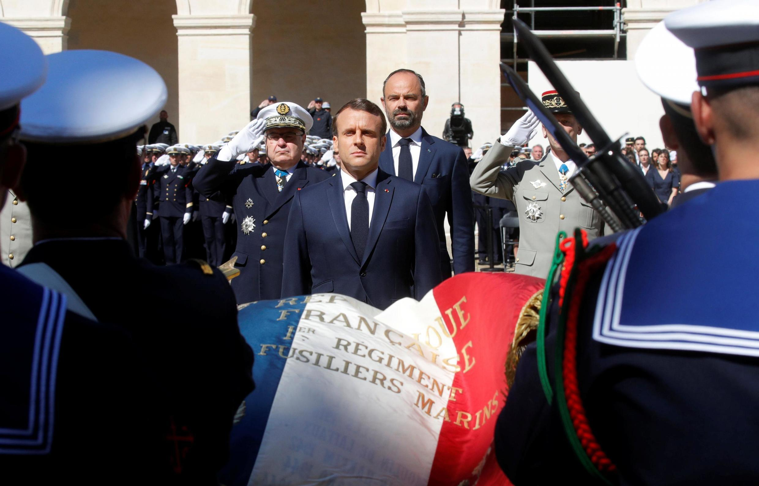 French President Emmanuel Macron honors the late special forces soldiers Cedric de Pierrepont and Alain Bertoncello, who were killed in a night-time rescue of four foreign hostages including two French citizens in Burkina Faso last week.