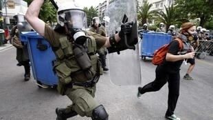 Police chase demonstrators in Athens on Wednesday