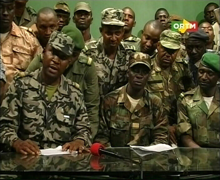 Renegade Malian soldiers appear on television at the ORTM television studio in Bamako