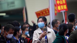 Chine - Travailleurs migrants à la gare photo du 19 mars 2020
