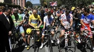 Tour de France riders observe a minute of silence for the victims of the attack in Nice, prior to the start of the fourteenth stage on July 16.