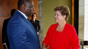 Dilma Rousseff multiplica suas visitas a África, como durante a III Cúpula América do Sul - África na Guiné Equatorial em março passado, quando se encontrou com o presidente de Senegal, Machy Sall