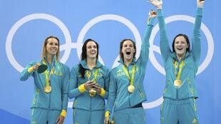 Emma McKeon, Brittany Elmslie, Bronte Campbell and Cate Campbell of Australia pose with their medals after winning the Women's 4 x 100m Freestyle Relay at the 2016 Olympics on 6 August 2016.