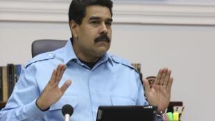 Le président vénézuélien Nicolas Maduro lors d'une réunion avec le haut commandement militaire et des ministres. Caracas, le 13 février 2014.