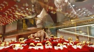A vendor arranges rings in a gold store in Huaibei, Anhui province September 29, 2010.