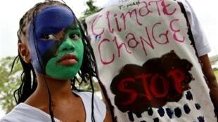 Des manifestations sur le climat ont eu lieu dans une centaine de pays du monde entier. «Justice pour le climat, maintenant ! » à la manifestation de Merebank en Afrique du Sud, le 12 décembre 2009.