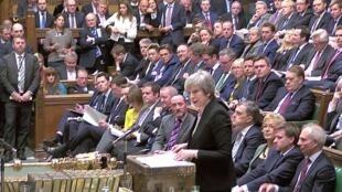 La Première ministre britannique Theresa May prend la parole lors d'un débat sur son «plan B» au Brexit au Parlement, à Londres, le 29 janvier 2019. Capture d'écran.