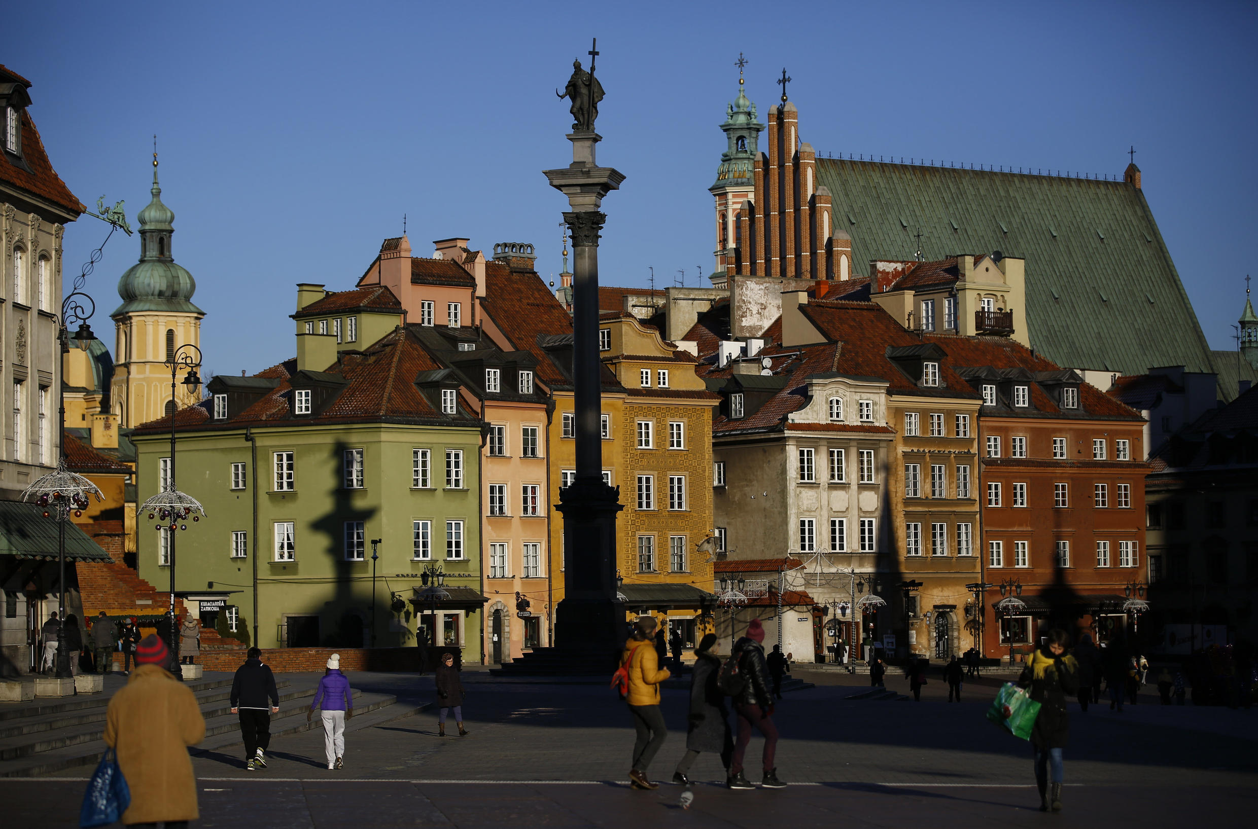The Old Town in front of the Sigismund's Column in Warsaw, Poland.