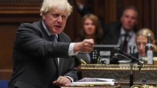 A handout photograph released by the UK Parliament shows Britain's Prime Minister Boris Johnson speaking during Prime Minister's Questions in the House of Commons in London on Wednesday.