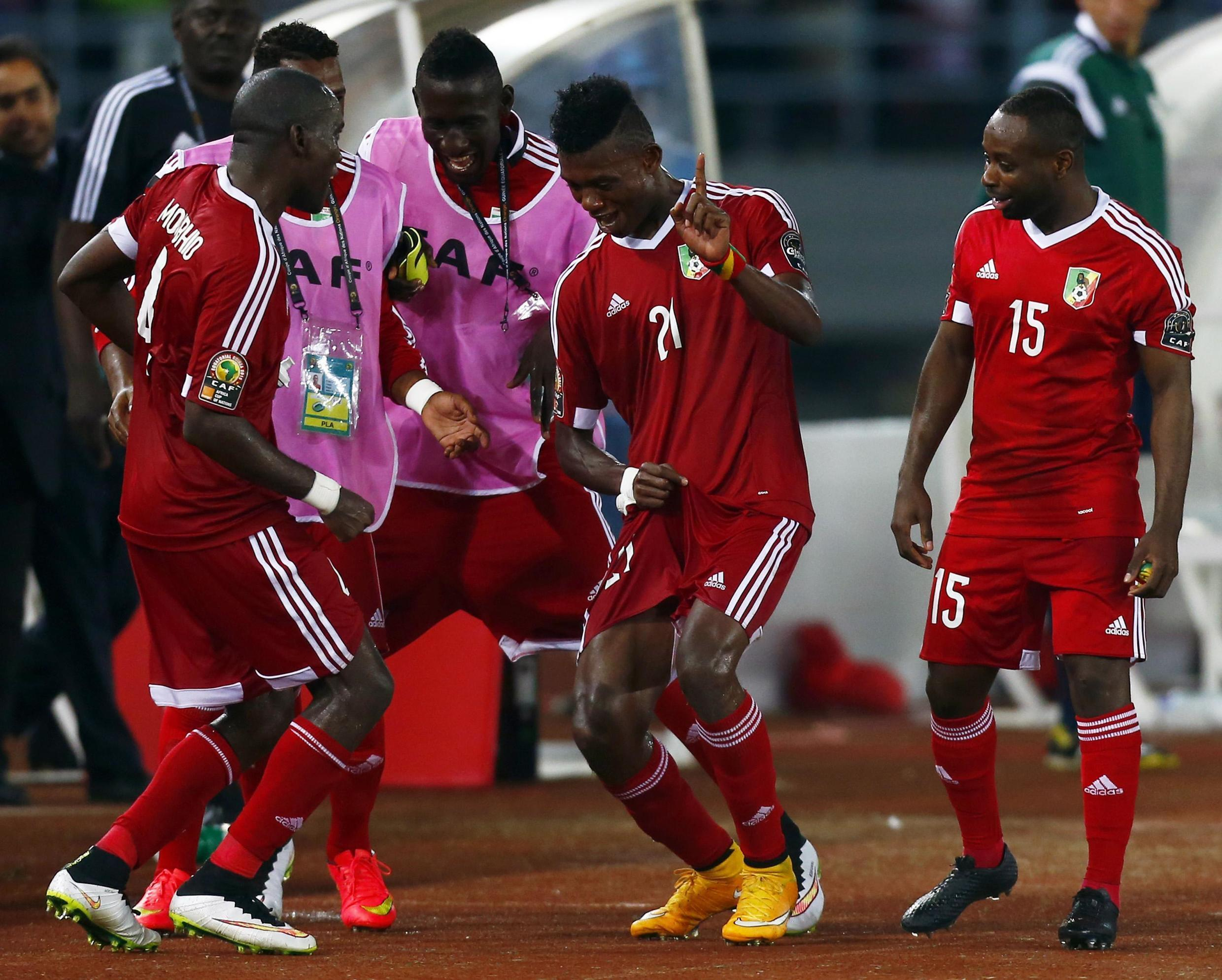 Congo's players celebrate and dance after they won their Group A soccer match against Gabon in the African Cup of Nations in Bata, Equatorial Guinea, 21 January 2015
