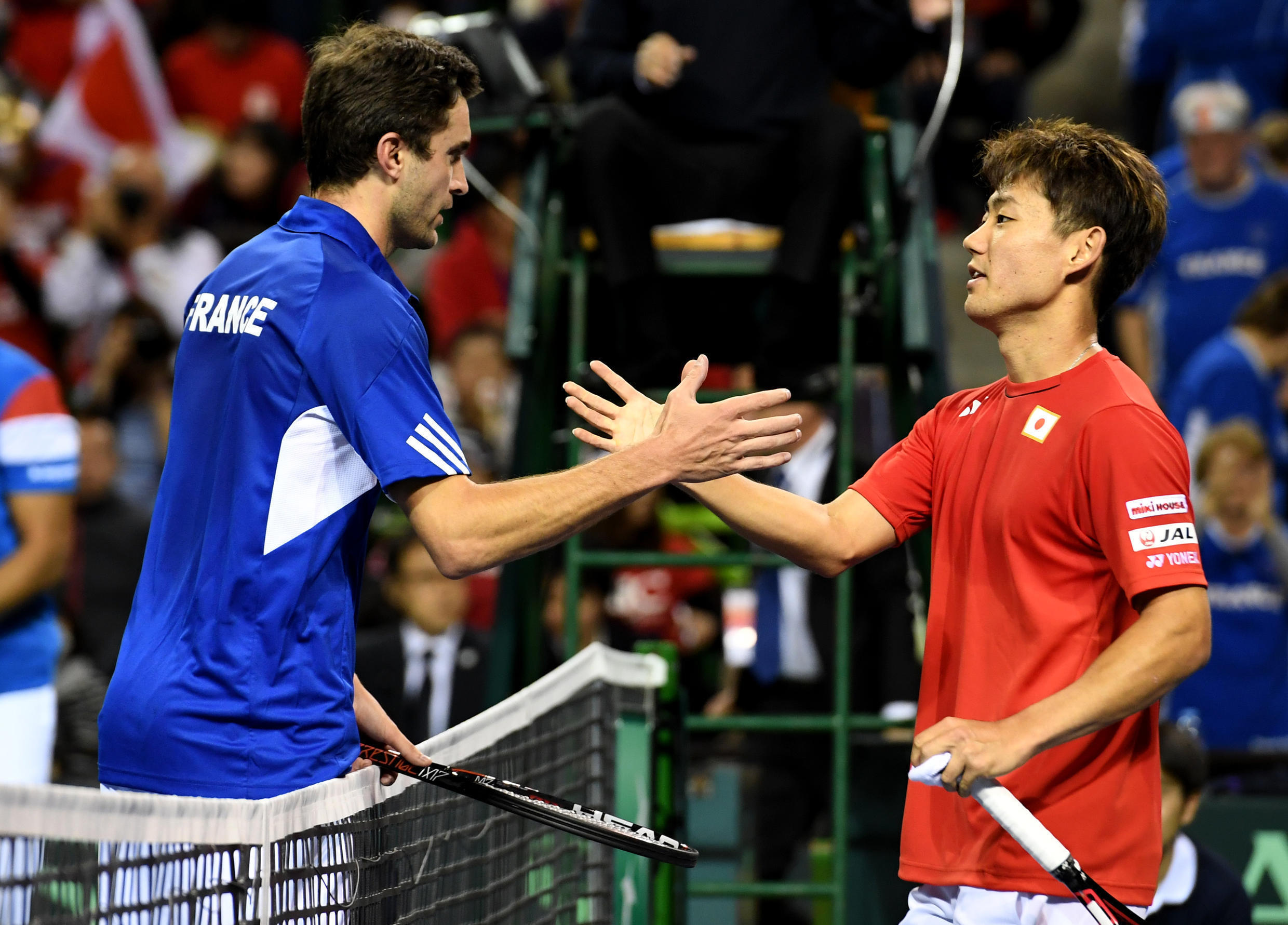 Gilles Simon is congratulated by Yoshihito Nishioka after their Davis Cup first round second match.