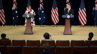 US Secretary of State Mike Pompeo listens while Australia's Foreign Minister Marise Payne speaks during a press conference .