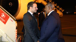 French President Emmanuel Macron is greeted by Djibouti's President Ismail Omar Guelleh upon his arrival in Djibouti, 11 March 2019.