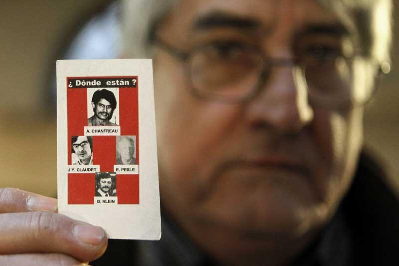 Bernard Alexandre Chanfreau, shows a photo of his brother Alphonse Rene Chanfreau and three others victims who disappeared during the Chilean dictatorship in the 1970's