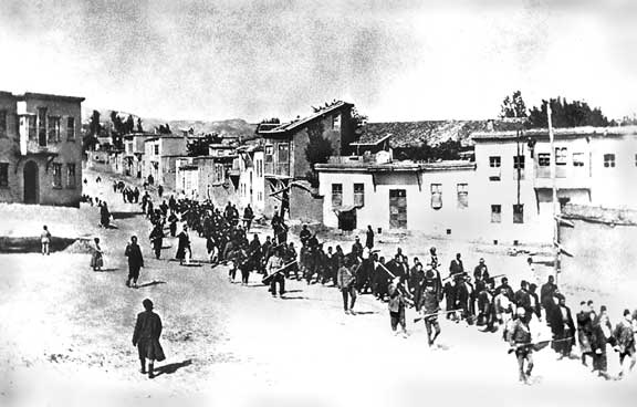 Turkish soldiers escort Armenian civilians out of a town in 1915