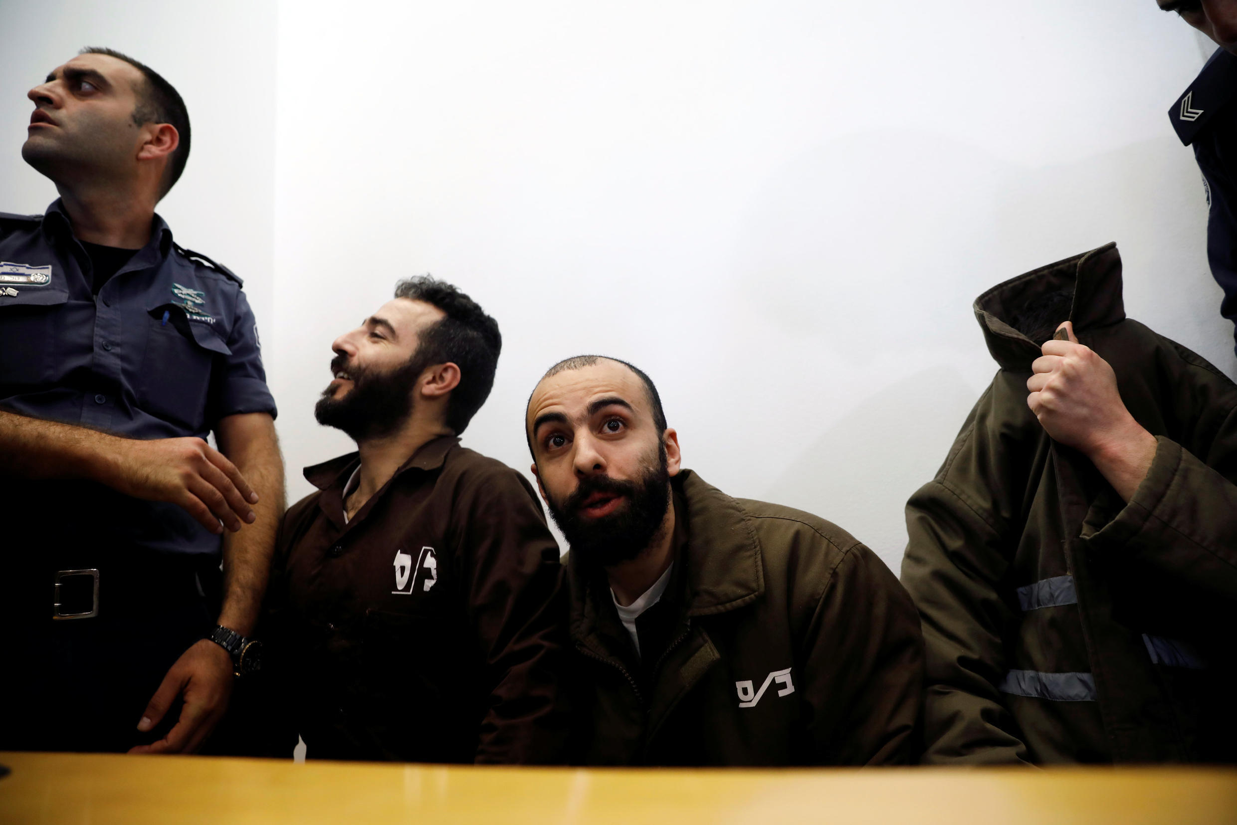 Romain Franck, an employee of the French consulate-general in Jerusalem, appears with co-defendants in the district court in Beersheba, Israel, March 19, 2018.