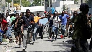 Running from the police during protests in Port-au-Prince