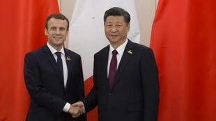 Los presidentes Emmanuel Macron y Xi Jinping en la cumbre del G-20 en Hamburgo, julio 2017