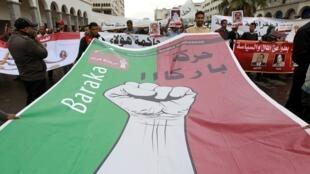 «Assez», peut-on lire sur la banderole, à Casablanca, le 24 avril  2011.