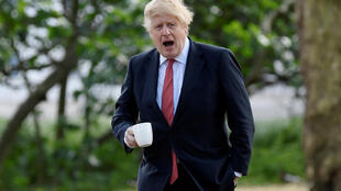 Britain's Prime Minister Boris Johnson goes for a walk in Central London following the outbreak of the coronavirus disease (COVID-19), London, Britain May 11, 2020.
