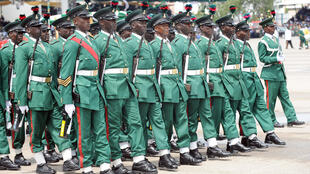 Nigerian soldiers march in Eagle Square during the celebrations to mark Nigeria's 50th independence anniversary 10 years ago