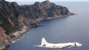 A Japanese jet fighter flies over the Senkaku/Diaoyu islands