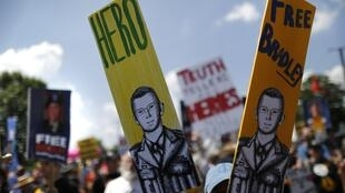 Marchers rally to call for Bradley Manning's release, outside the gates at Fort Meade, Maryland