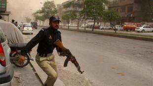 A policeman at an Ahmadi mosque in Lahore's Garhi Shahu neighbourhood